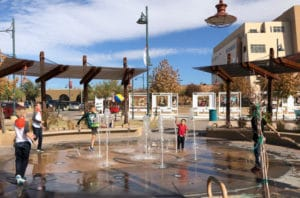 Children playing in Downtown Las Cruces splash pad in late November